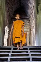 Monk walking Angkor Wat, Siem Reap Cambodia