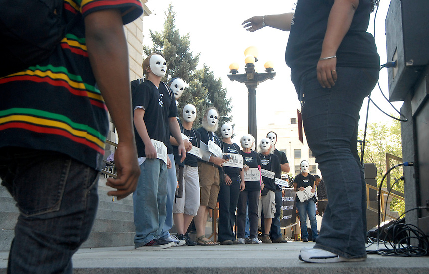 24 Aug 08: Protesters wearing masks prepare to march from the Colorado state capitol building to the Pepsi Center. On the day before the Democratic National Convention is scheduled to begin about 1,500 people participated in the ReCreate 68 rally, which included a march from the Colorado state capitol building to the Pepsi Center.