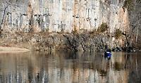 NWA Democrat-Gazette/DAVID GOTTSCHALK<br /> Mike MacDonald floats over the reflection of a portion of bluff line on the Current River.