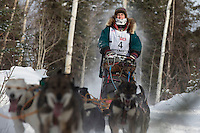 Jodi Bailey on the trail after leaving the restart of the Iditarod sled dog race in Willow, Alaska Sunday, March 3, 2013.