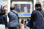 May 1, 2019, Tokyo, Japan - People watch a large screen which shows an enthronement ceremony of the new Emperor Naruhito in Tokyo on Wednesday, May 1, 2019. Former Emperor Akihito abdicated on April 30 and Crown Prince Naruhito ascended the throne on May 1.    (Photo by Yoshio Tsunoda/AFLO)