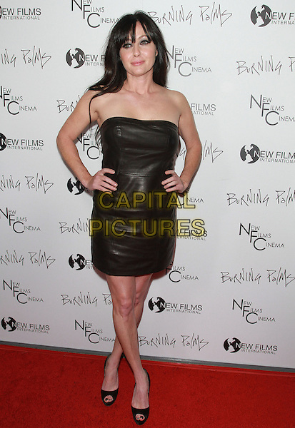 "SHANNEN DOHERTY.""Burning Palms"" Los Angeles Premiere held At The Arclight Theatres, Hollywood, CA, USA..January 12th, 2011.full length dress hands on hips strapless black leather .CAP/ADM/KB.©Kevan Brooks/AdMedia/Capital Pictures."