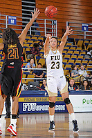 25 November 2011:  FIU guard-forward Finda Mansare (23) passes the ball while being defended by Maryland guard-forward Tianna Hawkins (21) in the second half as the University of Maryland Terrapins defeated the FIU Golden Panthers, 84-52, at the U.S. Century Bank Arena in Miami, Florida.
