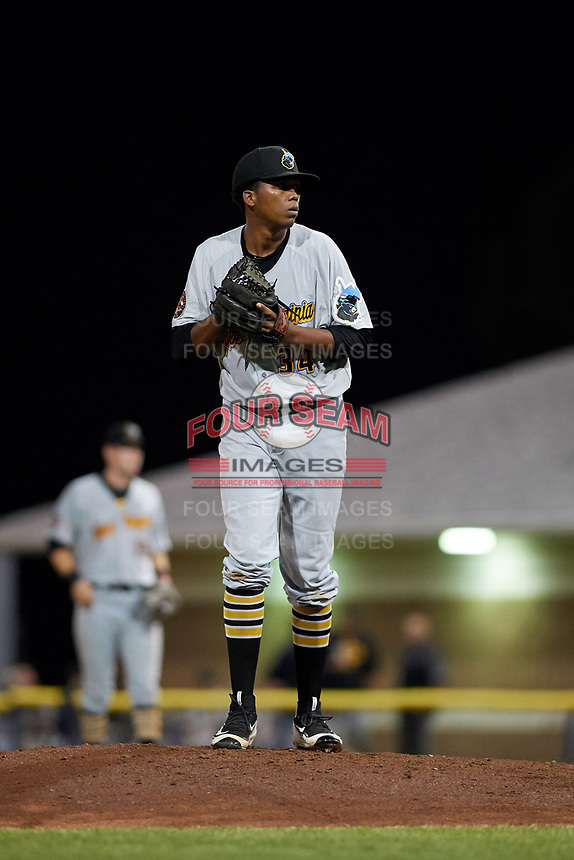 West Virginia Black Bears relief pitcher Francis Del Orbe (34) gets ready to deliver a pitch during a game against the Batavia Muckdogs on June 18, 2018 at Dwyer Stadium in Batavia, New York.  Batavia defeated West Virginia 9-6.  (Mike Janes/Four Seam Images)