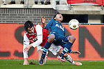 Nederland, Alkmaar, 25 november  2012.Eredivisie.Seizoen 2012-2013.AZ-Feyenoord.Jean Paul Boetius van Feyenoord wordt onderuitgeschopt door Steven Berghuis van AZ