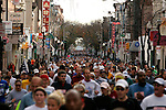 Runners continue on South Street before turning north on Sixth Street during the Philadelphia Marathon in Philadelphia, Pennsylvania on November 19, 2006.