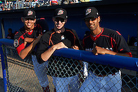 Batavia Muckdogs pitchers Justin Jacome, Travis Neubeck and Nestor Bautista (L-R) in the dugout before a game against the Auburn Doubledays July 10, 2015 at Dwyer Stadium in Batavia, New York.  Auburn defeated Batavia 13-1.  (Mike Janes/Four Seam Images)