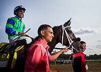SARATOGA SPRINGS, NY - AUGUST 26: By The Moon #4, ridden by Rajiv Maragh enters the winners circle after winning the Ballerina Stakes at Saratoga Race Course on August 26, 2017 in Saratoga Springs, New York.(Photo by Alex Evers/Eclipse Sportswire/Getty Images)