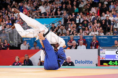 01.09.2012. Stratford, London, England.  Judo action Quarterfinals. u90 kilo Sam Ingram (GBR) blue, launches Dartanyon Crockett (USA) and goes on to win.