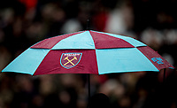 A West Ham United umbrella in the rain during the EPL - Premier League match between West Ham United and Southampton at the Olympic Park, London, England on 31 March 2018. Photo by Andy Rowland.