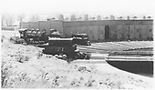 D&amp;RGW Alamosa roundhouse storage area with #494 and tenders from #71 and #345.<br /> D&amp;RGW  Alamosa, CO