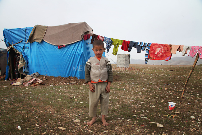 ARBAT, IRAQ: Murad Jamal, 4, from Derzor, Syria, is pictured in a refugee camp in Arbat, Iraq. ..The semi-autonomous region of Iraqi Kurdistan has accepted refugees from the conflict in Syria into several camps. Arbat lies near Sulaimaniyah in northeastern Iraq, approximately 500 kilometres from the Syrian border...Photo by Besaran Tofiq/Metrography