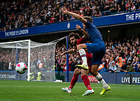 Mohamed Salah of Liverpool and Marcos Alonso of Chelsea during the Premier League match between Chelsea and Liverpool at Stamford Bridge, London, England on 22 September 2019. Photo by Liam McAvoy / PRiME Media Images.