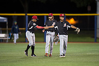 Salem-Keizer Volcanoes outfielders Diego Rincones (19), Nick Hill (14), and Aaron Bond (51) celebrate a victory after a Northwest League game against the Hillsboro Hops at Ron Tonkin Field on September 1, 2018 in Hillsboro, Oregon. The Salem-Keizer Volcanoes defeated the Hillsboro Hops by a score of 3-1. (Zachary Lucy/Four Seam Images)