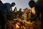 Palestinian protesters prepare dinner during clashes with Israeli security forces in a protest, at the Israel-Gaza border, demanding the right to return to their homeland, in Khan Younis in the southern Gaza strip on April 1, 2018. Photo by Yasser Qudih