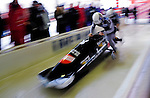 18 December 2010: Manuel Machata pushes his 2-man bobsled for Germany, taking 6th place at the Viessmann FIBT World Cup Bobsled Championships on Mount Van Hoevenberg in Lake Placid, New York, USA. Mandatory Credit: Ed Wolfstein Photo
