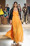 Model walks runway in an orange strapless silk tulle KELWYN gown and black sequin BRUCE baseball jacket from, the Greta Constantine Spring Summer 2018 collection by Kirk Pickersgill and Stephen Wong on September 6, 2017; at Pier 59 Studios during New York Fashion Week.