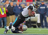 Jacksonville Jaguars receiver Marqise Lee (11) is tackled by New England Patriots linebacker Elandon Roberts (52) in the AFC Championship game Sunday, January 21, 2018 in Foxboro, MA.  (Rick Wilson/Jacksonville Jaguars)