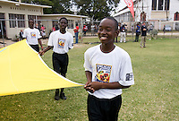 A young boy carries the FIFA Fair Play flag onto the field during the group stage of the CONCACAF Men's Under 17 Championship at Jarrett Park in Montego Bay, Jamaica. Panama tied Cuba, 0-0.