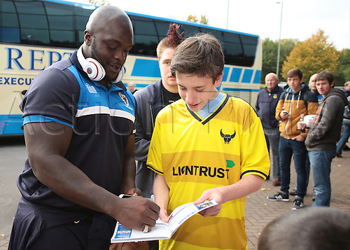 10.10.2015. Kassam Stadium, Oxford, England. Skybet League 2. Oxford United versus AFC Wimbledon. Adebayo Akinfenwa of AFC Wimbledon signs an autograph on his arrival
