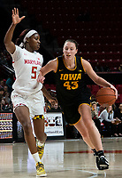 COLLEGE PARK, MD - FEBRUARY 13: Amanda Ollinger #43 of Iowa moves past Kaila Charles #5 of Maryland during a game between Iowa and Maryland at Xfinity Center on February 13, 2020 in College Park, Maryland.
