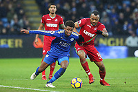 Demarai Gray of Leicester City is challenged by Jordan Ayew of Swansea during the Premier League match between Leicester City and Swansea City at the King Power Stadium, Leicester, England, UK. Saturday 03 February 2018