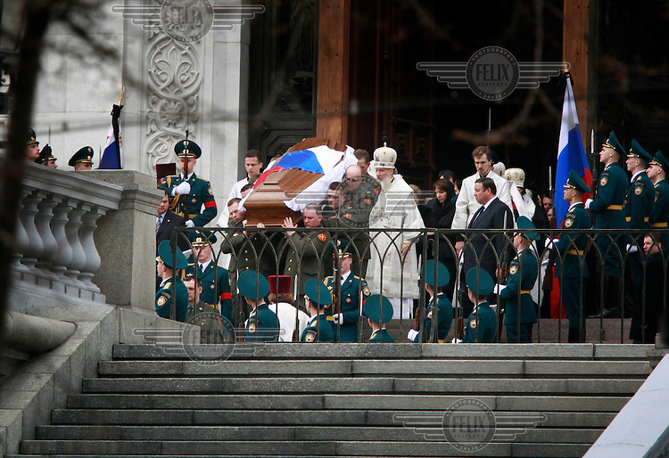 The coffin of former president Boris Yeltsin is carried out of the Cathedral of Christ the Saviour following his funeral, two days after his death from heart failure at the age of 76.
