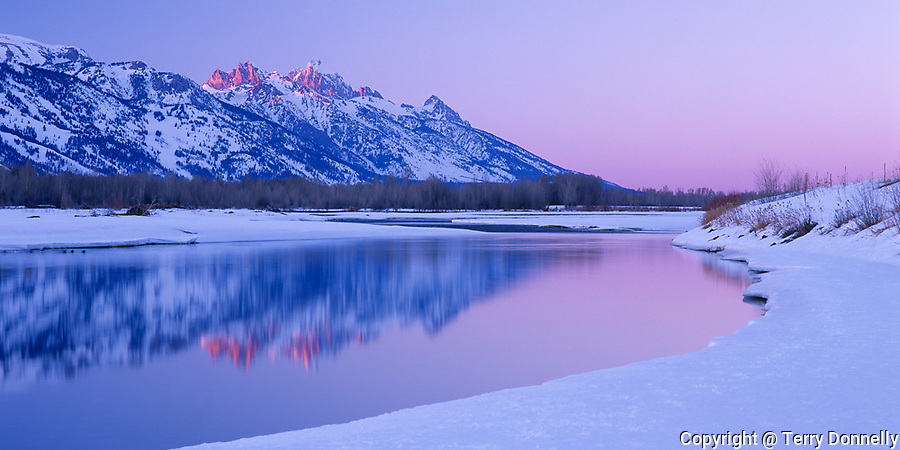 Grand Teton National Park, WY<br /> Sunset light on the Teton Peaks with reflections on the Snake River in winter -  from Jackson Hole
