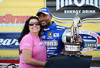 Apr. 3, 2011; Las Vegas, NV, USA: NHRA top fuel dragster driver Antron Brown celebrates with wife Billie Jo Brown after winning the Summitracing.com Nationals at The Strip in Las Vegas. Mandatory Credit: Mark J. Rebilas-