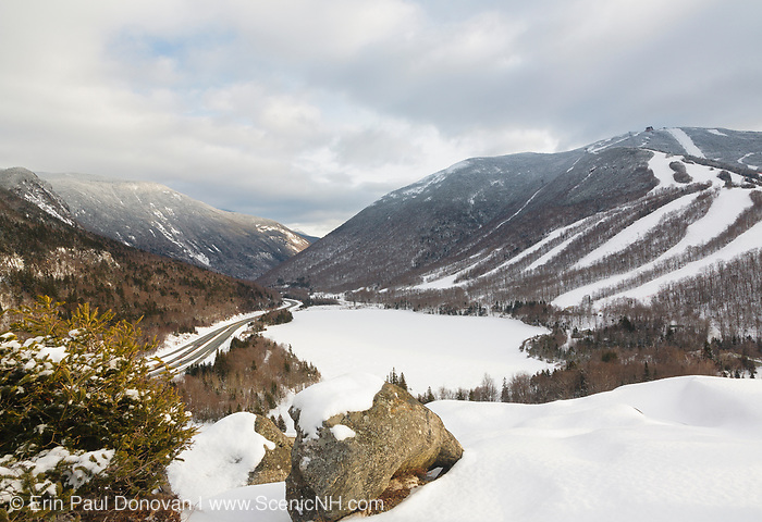 Franconia Notch State Park from Artists Bluff during the winter months in the White Mountains, New Hampshire. Echo Lake (center) is frozen over and Cannon Mountain is on the right.