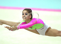 2 OCTOBER 1999 - OSAKA, JAPAN: Teodora Alexandrova of Bulgaria performs straddle jump with rope at the 1999 Rhythmic Gymnastics World Championships in Osaka, Japan. Teodora placed 8th in the individual all around.
