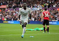 Pictured: Bafetimbi Gomis of Swansea celebrates his goal, making the score 2-1 to his team Sunday 30 August 2015<br />