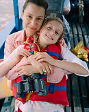 PERU, Amazon Rainforest, South America, Latin America, portrait of a happy mother and daughter travelling in boat