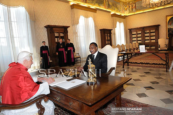 President of the Republic of Congo Denis Sassou-Nguesso, left, presents his delegation to Pope Benedict XVI, on the occasion of their private audience in the pontiff's private library, at the Vatican, Monday, May 24, 2010.