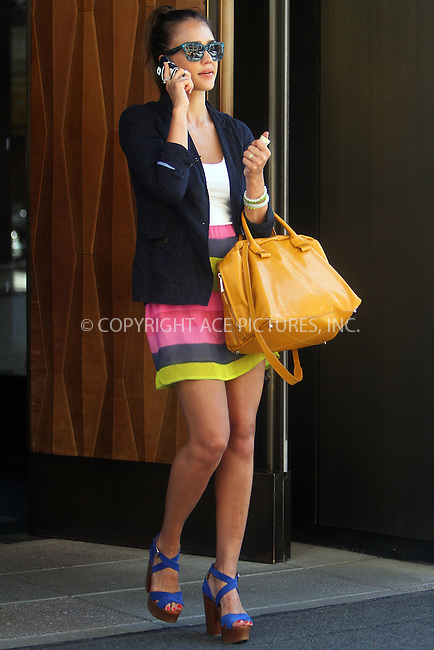 WWW.ACEPIXS.COM . . . . .  ....July 25 2012, New York City....Actress Jessica Alba wears a bright summery outfit as she leaves a Soho hotel on July 25 2012 in New York City....Please byline: NANCY RIVERA- ACEPIXS.COM.... *** ***..Ace Pictures, Inc:  ..Tel: 646 769 0430..e-mail: info@acepixs.com..web: http://www.acepixs.com