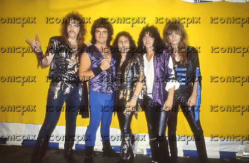 DIO -L-R: Claude Schnell, Vinny Appice, Ronnie James Dio, Jimmy Bain, Craig Goldy -  photocall backstage at the Monsters of Rock festival at Castle Donington UK - 22 Aug 1987.  Photo credit: George Bodnar Archive/IconicPix