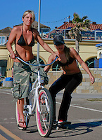 Destiny Newton tows her friend Mallory Stone down the boardwalk on her skateboard in Mission Beach Friday February 8, 2008.