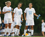 07 September 2007: North Carolina's Allie Long (33), Casey Nogueira (54) and Tobin Heath (98). The University of North Carolina Tar Heels defeated the Texas A&M University Aggies 2-1 at Fetzer Field in Chapel Hill, North Carolina in an NCAA Division I Women's Soccer game, and part of the annual Nike Carolina Classic tournament.