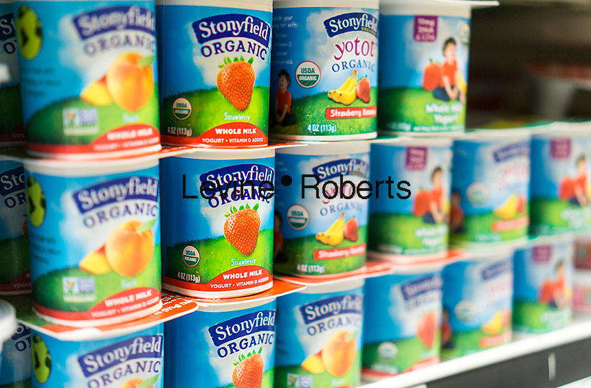 Containers of Stonyfield Farm organic yogurt in a supermarket cooler in New York on Wednesday, May 10, 2017. Yili Industrial Group, china's largest dairy producer, is reported to be in talks with Danone to buy the organic yogurt company Stonyfield Farm. Dean Foods is reported to be still in the auction. (© Richard B. Levine)