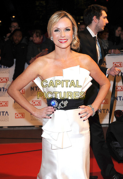 AMANDA HOLDEN.Arrivals at the 15th National Television Awards held at the O2 Arena, London, England. .January 20th, 2010 .NTA NTAs half length black waistband white dress gown brooches folded front silk satin hands on hips .CAP/BEL.©Tom Belcher/Capital Pictures