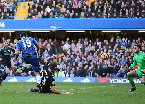 11.12.2016. Stamford Bridge, London, England. Premier League Football. Chelsea versus West Bromwich Albion. Chelsea Forward Diego Costa scores past West Brom Goalkeeper Ben Foster, 1-0 Chelsea
