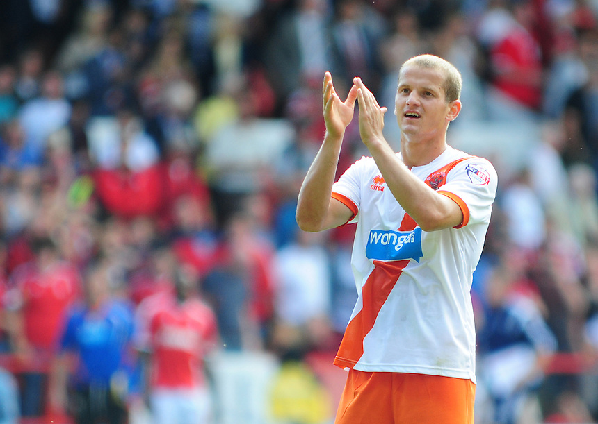 Blackpool's Tomasz Cywka applauds the fans at the end of the game<br /> <br /> Photographer Chris Vaughan/CameraSport<br /> <br /> Football - The Football League Sky Bet Championship - Nottingham Forest v Blackpool - Saturday 9th August 2014 - The City Ground - Nottingham<br /> <br /> &copy; CameraSport - 43 Linden Ave. Countesthorpe. Leicester. England. LE8 5PG - Tel: +44 (0) 116 277 4147 - admin@camerasport.com - www.camerasport.com
