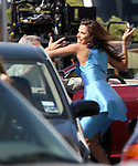 3-10-08.Exlclusive..Eva longoria Filming a fight scene with a man in a wheel chair Eva takes his phone and throws it. Felicity Huffman was in a scene with Eva also while filming desperate housewives in Los Angeles...AbilityFilms@yahoo.com.805-427-3519.www.AbilityFilms.com