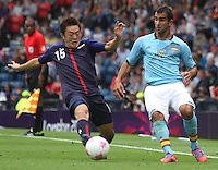 Men's Olympic Football match Spain v Japan on 26.7.12...Manabu Saito of Japan and Martin Montoya of Spain, during the Spain v Japan Men's Olympic Football match at Hampden Park, Glasgow.........
