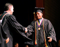 Devin Connor Ramadan (R) shakes hands with Principal Richard Heffernan as he receives his diploma during the 64th Commencement ceremony at Palisades High School Friday June 12, 2015 in Kintnersville, Pennsylvania.  (Photo by William Thomas Cain/Cain Images)