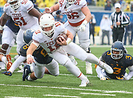 Morgantown, WV - November 18, 2017: Texas Longhorns quarterback Sam Ehlinger (11) runs for a first down during game between Texas and WVU at  Mountaineer Field at Milan Puskar Stadium in Morgantown, WV.  (Photo by Elliott Brown/Media Images International)