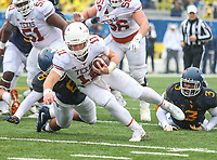 Morgantown, WV - November 18, 2017: Texas Longhorns quarterback Sam Ehlinger (11) runs for a first down during game between Texas and WVU at  Mountaineer Field at Milan Puskar Stadium in Morgantown, WV.  (Photo by Elliott Brown/Media Images International)