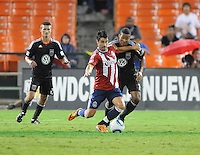 Chivas USA forward Juan Pablo Angel (9) goes against D.C. United defender Ethan White (15). Chivas USA tied D.C. United 2-2 at RFK Stadium, Wednesday  September 20 , 2011.