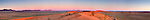 Panorama of Roter Kamm Impact Crater in the Sperrgebiet with Aurus Mountains in the background at sunset