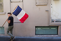 San Francisco, CA - Friday, June 20, 2014:  French-American soccer fan Louis-Pierre Guidetti of Mill Valley carries a France flag after watching the France vs. Switzerland first round World Cup match at Cafe Bastille in San Francisco, CA.